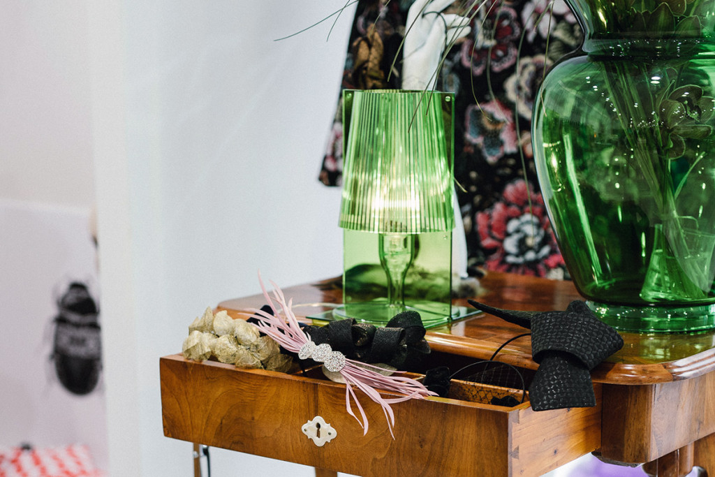 Kartell lamps, Ana Lazovski head pieces, and antique furniture by Antikvitete Lipovec at PENTLJA CONCEPT STORE